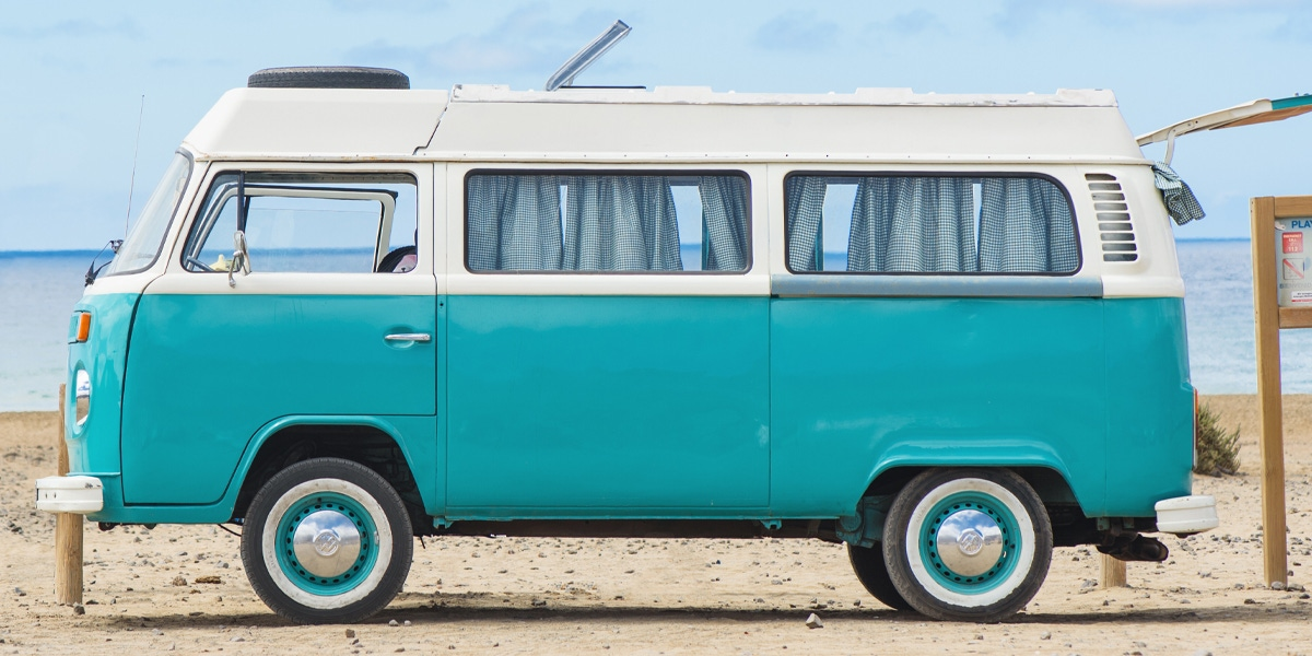 Camper with surfboard